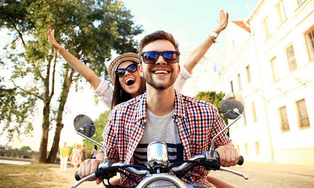 Scooter- of e-bikerverhuur voor een hele dag