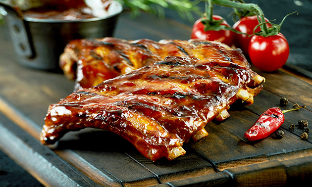 Afhalen: halve kip of spareribs met friet bij Steakhouse Bella